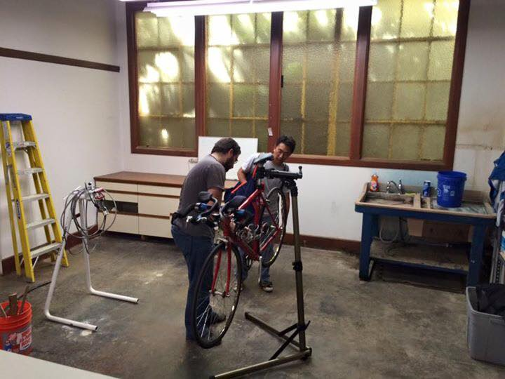 Volunteers repairing a bike at San Jose Bike Clinic